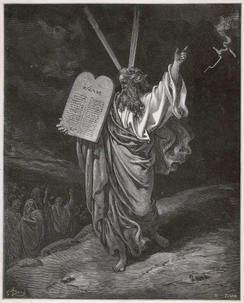 Moses descends from the mountain carrying the Tables of the Law on which God has inscribed the Ten Commandments