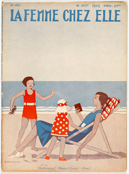 Mother reads a book in a deckchair while her children show her the crabs they have caught