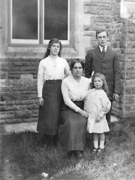 A mother and her three children looking rather glum, Mid Wales
