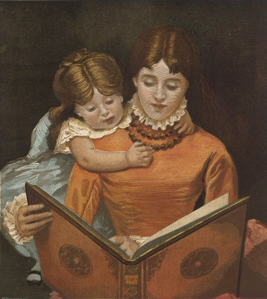Mother reads a large book while her daughter hangs over her shoulders