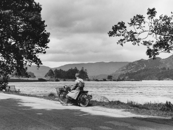 A motorcyclist pauses to admire the view at Ullswater, the 'English Lucerne' one of the most beautiful of the lakes in the Lake District