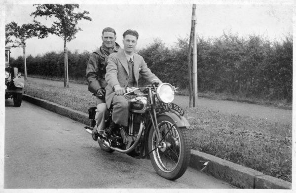 Two young men out on their motor cycle