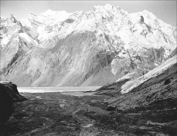 A mountain scene in Kashgar, western China, with a snow-covered mountain in the middle distance. Photograph by Ralph Ponsonby Watts