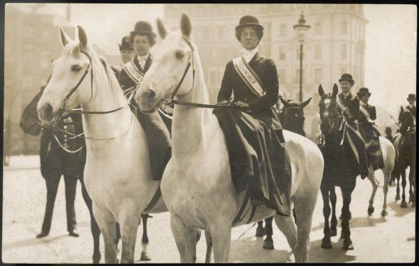 Mrs Evelina Haversfield & Miss Maud Joachim in a mounted demonstration. They are wearing 'Votes for Women' sashes. Date: circa 1910