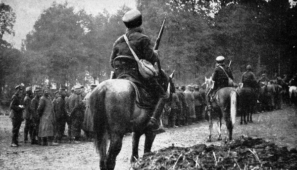 Photograph showing French Algerian Spahis on horseback guarding German soldiers captured during the Battle of the Somme, 1916