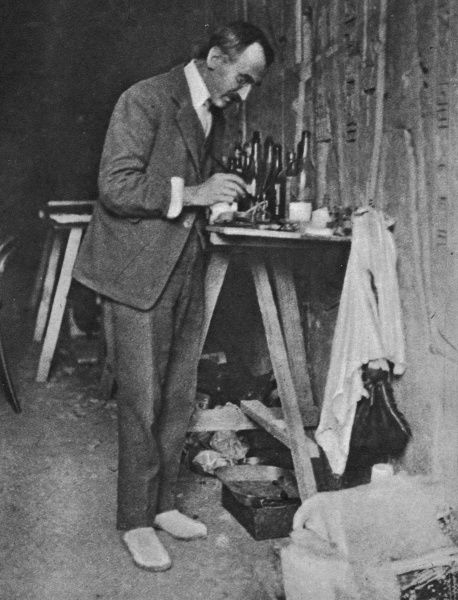 The photograph shows Mr. Alfred Lucas, Director of the Chemical Department of the Egyptian Government, moistening a 3000 year-old object from the Tomb of Tutankhamun with a brush for preservation