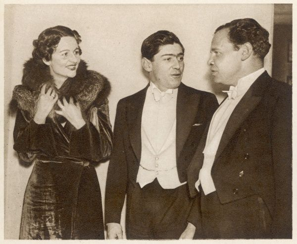 The Hon. Mrs Peter Rodd aka Nancy Mitford (1904 - 1973), British author, biographer and society figure. Pictured talking to Lord Stanley of Alderley and Mr John Sutro at the opening of the new San Marco restaurant in London