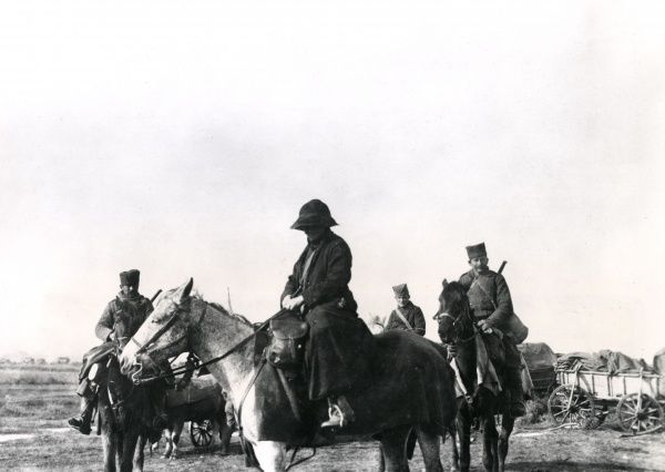 Commandant Mrs St Clair Stobart (Mabel Anne Stobart Greenhalgh, 1862-1954) and Serbian orderlies on horseback as she led the column in the retreat, en route for Petch (Pec), during the First World War