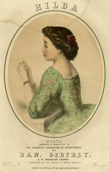Music cover for Hilda, a waltz by Dan Godfrey, dedicated to the Baroness Ferdinand de Rothschild. Showing a young woman sitting contemplating a miniature portrait of the man she loves. Date: 19th century