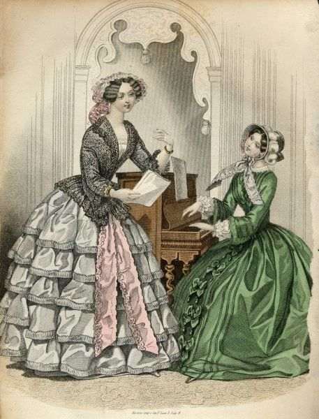 Skirt with 5 flounces, black lace jacket & broad floating ribbon ends descending from the waist. Green redingote: bow trim, undersleeves with reversed vandyked cuffs