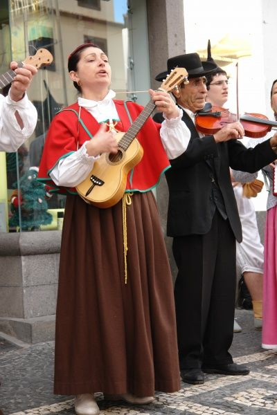 Musicians belonging to a folklore group from Gaula, seen here in traditional dress performing on the street in Funchal, the capital city of Madeira