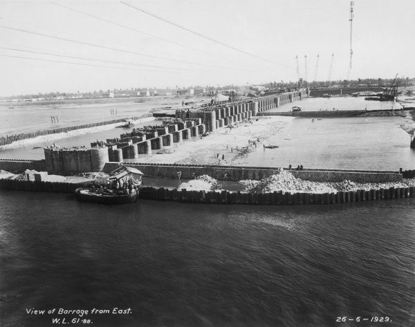 View of the barrage from the east, showing the ever-expanding row of gate piers - 26th June 1929. Photograph from an album commemorating the opening of the Nag Hammadi Barrage (dam) in 1930