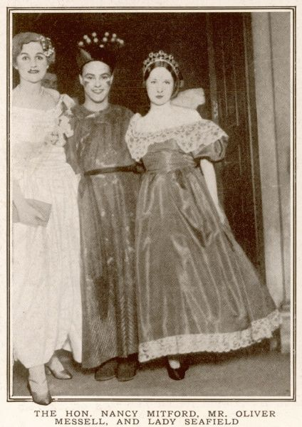 A photograph of a Nancy Mitford, Oliver Messell and Lady Seafield at Mrs A. G. Glasgow's fancy dress ball