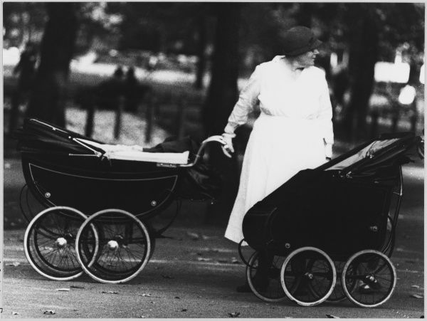 A Nanny is left holding the prams during an outing