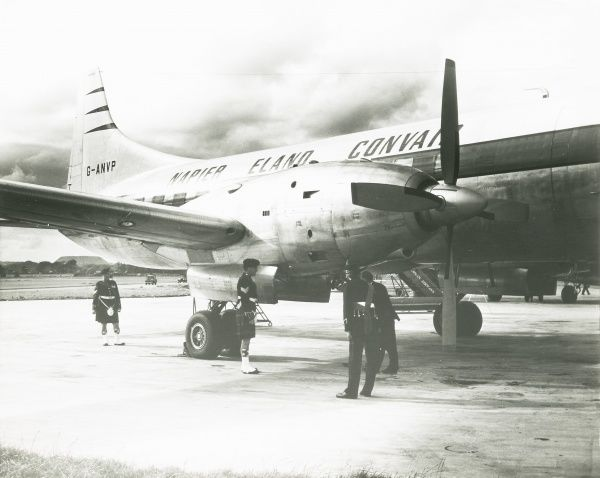 Napier Eland Airliner G ANVP converted with turboprop engines on runway with men in kilts Date: 1956