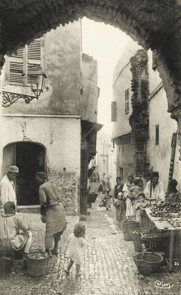 Narrow street in the Kasbah, Algiers. A kasbah or Qassabah is a type of medina, Islamic city, or fortress
