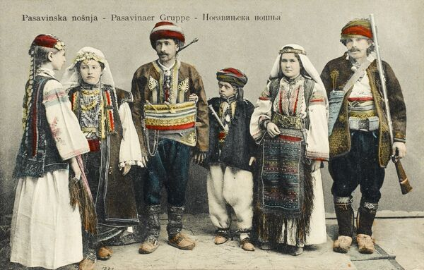 A group of men, women and children in the traditional national dress of Croatia
