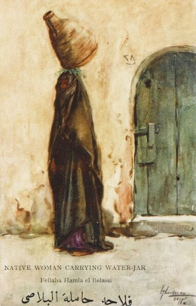Native Egyptian Woman carrying a large jar of water