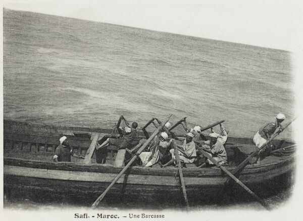 A large traditional Moroccan rowing barge off the coast at Safi, Morocco