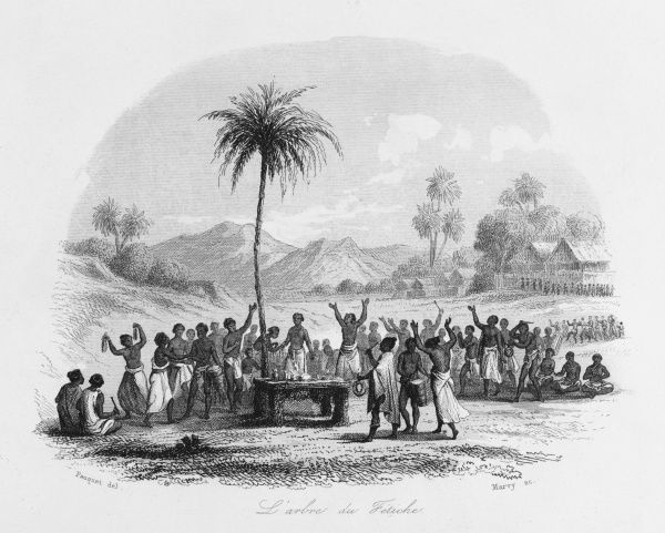 Natives of the Gold Coast (now Ghana), West Africa, worship at their fetish tree