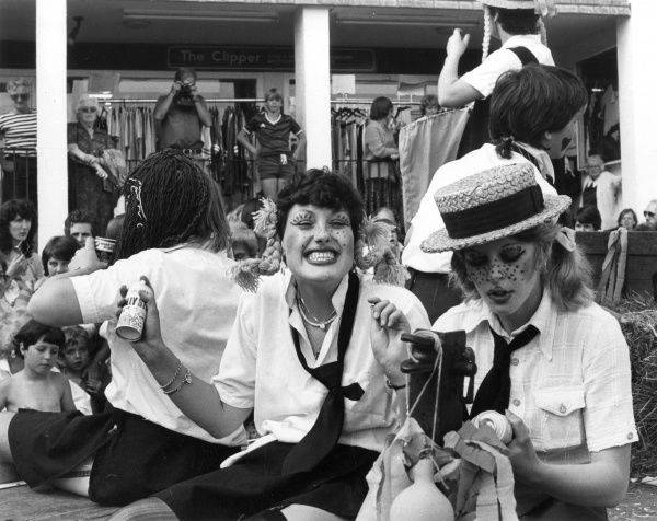 Girls dressed up as naughty 'St. Trinian's' style schoolgirls at the St. Ives Carnival, Cornwall, England. Date: 1980s