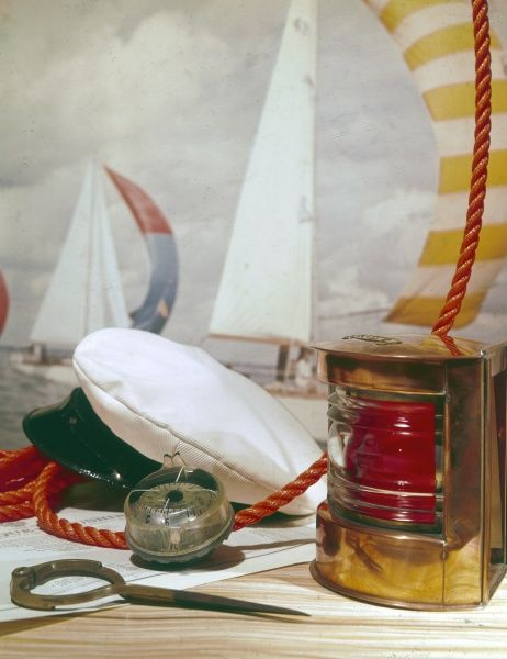 Nautical equipment for the seasoned sailor, including a Captain's cap, compass, hurricane lamp, rope, etc