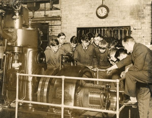 A group of boys is taught about steam driven electric generators, which light and heat ships. They hope to become navy cadets one day