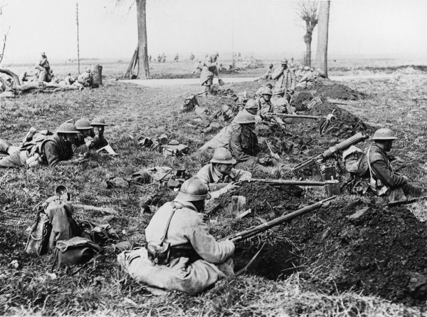 Men of the 20th British Division and the 22nd French Division in hastily dug rifle pits covering a road, in the Nesle sector of the Somme region