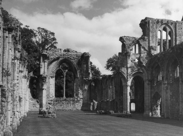 A glimpse of the ruins of Netley Abbey, close to Southampton Water, Hampshire, a Cistercian foundation of 1239 and endowed by King Henry III. Date: 13th century