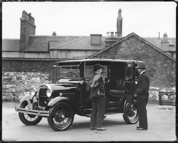 One of the 'new' Ford motor taxi cabs