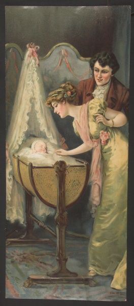 Two new, proud parents admire their sleeping newborn who lies in an elegant rocking cradle