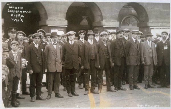 New recruits at Wells. A crowd of men in suits gather to offer their services