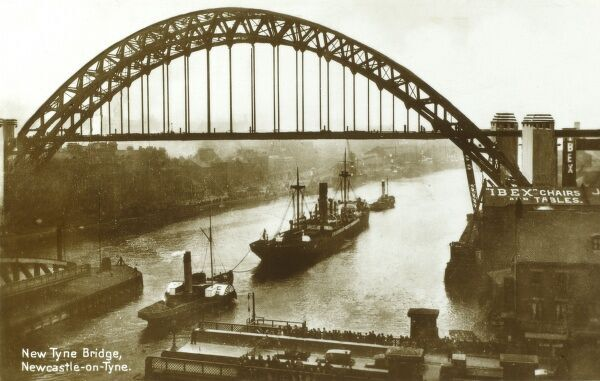 The New Tyne Bridge, Newcastle upon Tyne with the swing bridge in the foreground. The bridge was opened by King George V on 10th October 1928 Date: circa 1930