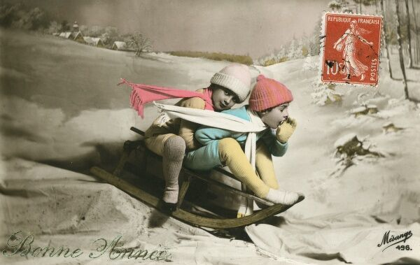 New Year card - two children on a sled in the snow (albeit in a photographic studio!). One would imagine that the shout of warning for the impending swift arrival (note the fake wind effect on the scarves!) of this naughty twosome is slightly unnecessary