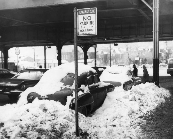 Parked vehicles, abandoned in deep snow during bad winter weather which has lasted for over 2 months. A costly headache for snow removers in New York, U.S.A. Date: 1960s