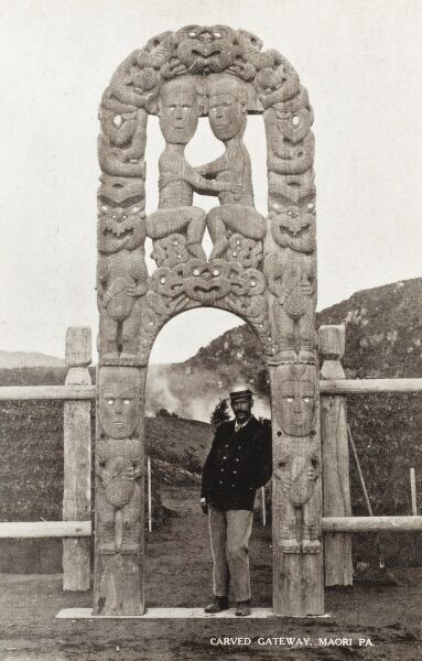 New Zealand - Carved Maori Gateway, with a dapper Gent standing within the lower arch giving an accurate idea of the scale
