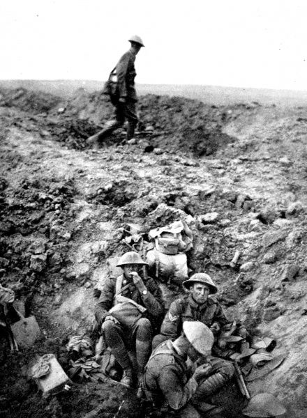 New Zealand soldiers are pictured resting in a shell-hole near German front lines in September 1916. The caption to the image notes that the New Zealand men had 'done great deeds in the recent fighting.&#39