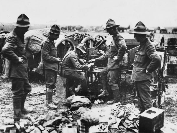 New Zealand machine gunners fitting machine belts during World War I