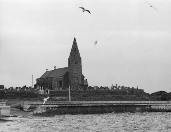St. Bartholomew's Church, on Newbiggin Point, Newbiggin-by- Sea, Northumberland, England. This 14th century building is a well-known landmark to sailors. Date: 14th century