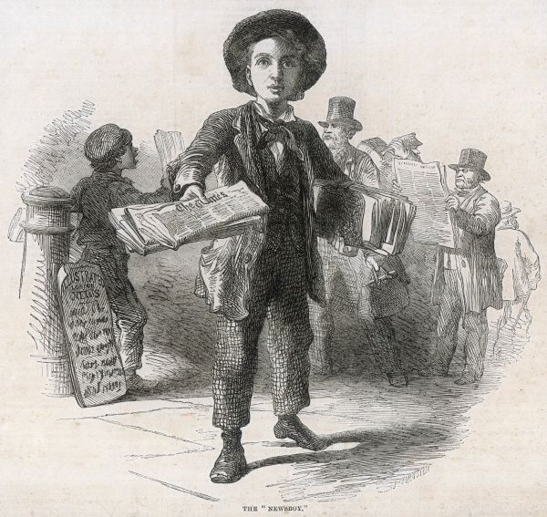 A newsboy selling copies of The Times newspaper in the street. Another boy behind him appears to be selling The Illustrated London News while men in top hats peruse the papers immediately on buying them