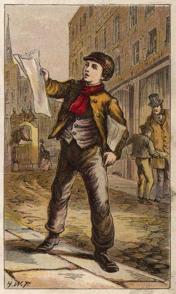 A London newsboy, in red muffler and peaked cap, sells papers on the street