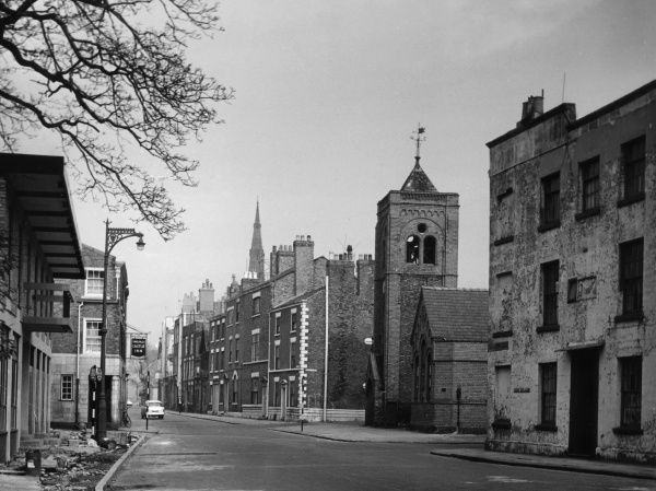 Nicholas Street, Chester, Cheshire, England, shortly before it was demolished to make way for an inner ring road. Date: 1964