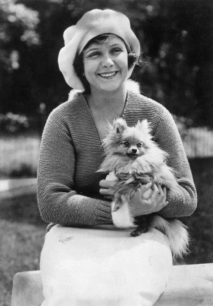 NORMA TALMADGE American silent film actress, with her little dog Date: 1897 - 1957