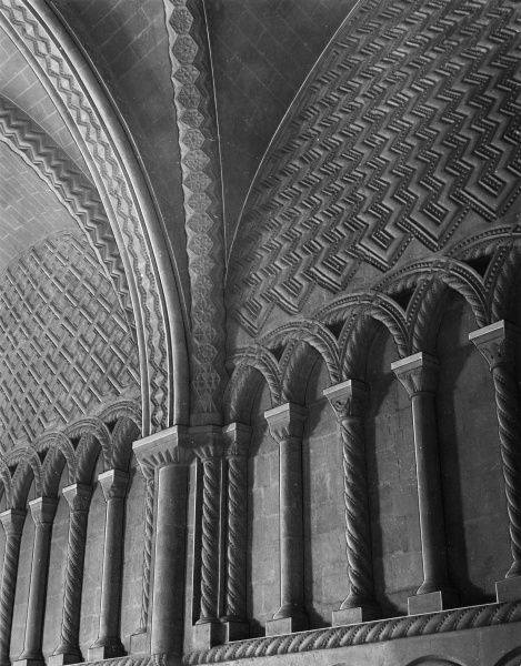The fine archading and dog- tooth mouldings in the Chapter House of Bristol Cathedral, some of the finest examples of Norman architecture in England. Date: 12th century