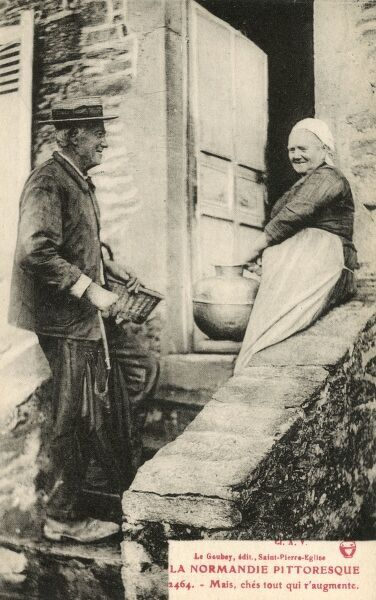 An elderly couple having a chat on a set of steps, Normandy, France. The old lady carries a large water or milk jar/pail, whilst the straw boater-wearing gentleman carries an umbrella and a small wicker basket. Date: circa 1910s