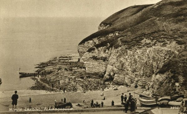 View of the North Landing at Flamborough, North Yorkshire, with boats and holidaymakers. Date: 1940s