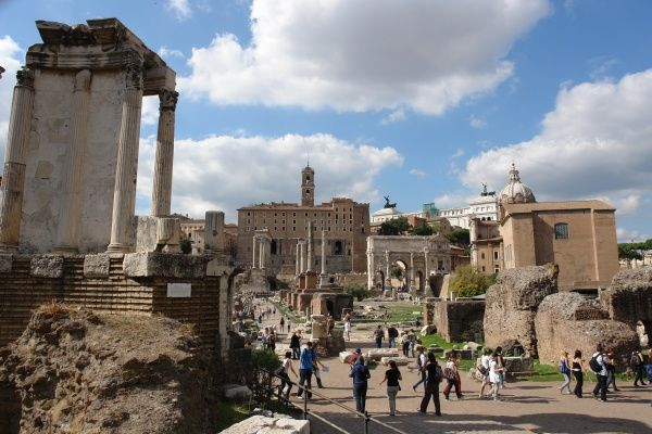 View towards the north side of the Roman Forum, or Forum Romanum, in Rome, Italy, with sightseers walking through