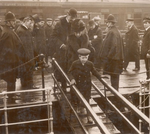 King Haakon VII of Norway (1872-1957) and Queen Maud (1869-1938), together with their son, Crown Prince Olav (1903-1991), embarking at Dover to return home following a visit to the UK