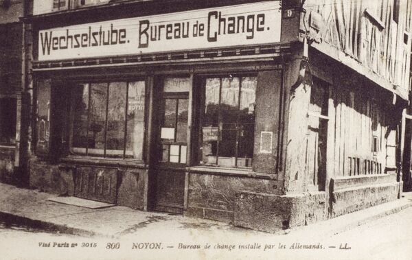 Noyon, France - Bureau de Change installed by occupying German Forces. The town was occupied by the Germans during World War I and World War II and on both occasions suffered heavy damage. Date: circa 1918