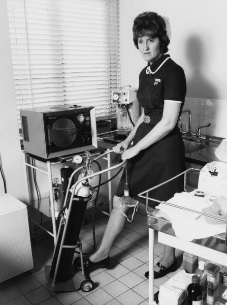 Scene at the Metropolitan Police Medical Centre, Hendon, north west London, with a nurse wheeling an oxygen cylinder